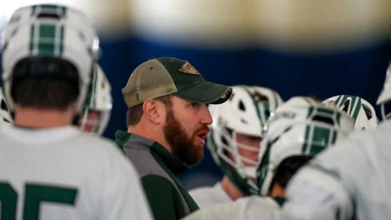 CSU Lacrosse coach Andy German inside the huddle with his team