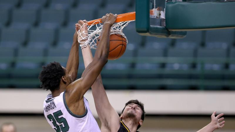 Cleveland State's Deante Johnson slams a dunk during a game against Detroit Mercy on Feb. 13